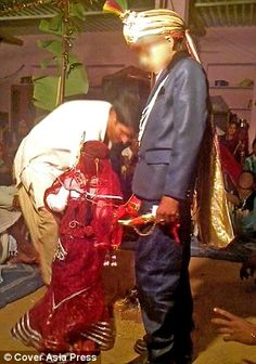 One of the child brides, a five-year-old, is seen dressed in a Hindu bridal dress and is forced to walk around the fire with her child groom, an 11-year-old