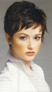 Cute Wispy Pixie Haircut is Cut Slightly Asymmetrical and a lot of Fringe is added to this Sassy Pixie Hairstyle.  Bangs are Chipped or bitten cut, and Short Layered are Cut through-out interior.