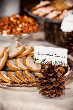 use pinecones to display paper goods for a winter wedding // photo by MatthewMoorePhotography.com