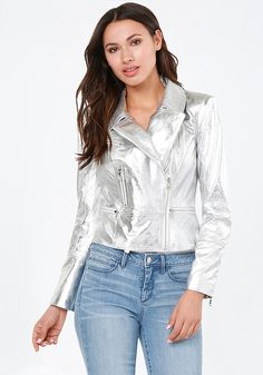 Futuristic moto jacket in a fabulous silver leather. Shaping seams and shoulder pads create a powerful look. Zip pockets and waist detail. Front asymmetric zip closure. Fully lined.