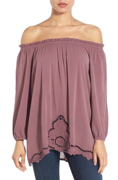 Obsessing over this gorgeous off the shoulder top in purple for a fun and chic spring look.