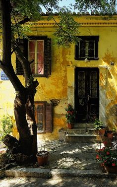Old Athens yellow plaster home by Sunsword & Moonsabre.