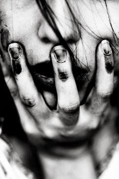 I really like this photo and it's dramatic look. Blurred hand puts more attention on fingers covering mouth and nose.