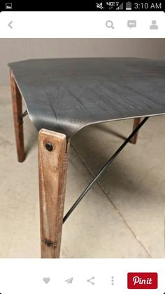 Bent steel and wood table