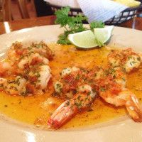 Custom Fish/Shrimp Plate - Your choice of broiled fish (shrimp, salmon and tilapia) served with one of our specialty sauces – Al Mojo de Ajo, Al Chipotle or Al Limon.  Served with rice and a complimentary salad.    *Pictured is Shrimp Al Chipotle – butterflied shrimp served in our spicy smoked jalapeño butter.