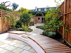 designed this Clapham Old Town garden to have a cottage garden feel with a windy path and space for a terrace flower garden and vegetable patch. Garden Retaining Wall, Sloped Garden, Retaining Walls, Garden Seating, Terrace Garden, Back Gardens, Outdoor Gardens, Built In Seating, Garden Steps