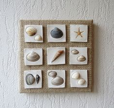 This wall decoration is made on canvas using sackcloth, clay and seashells. The size is 20 x 20 cm.
