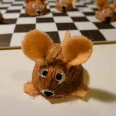 Funny mouse made out of walnut shell and felt