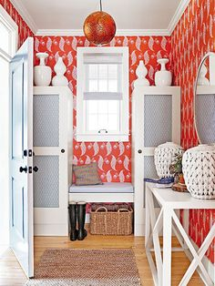 Pretty, patterned wallpaper sets a welcoming tone suited to a space that sees high traffic but less heavy-duty wear and tear.