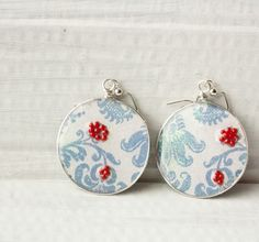 A personal favorite from my Etsy shop https://www.etsy.com/listing/240784239/light-blue-floral-earrings-ice-resin