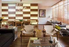 Linda sala de estar decorada com a poltrona Kilin - Sergio Rodrigues