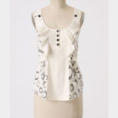 Anthropologie Mirror Mirror tank I'm selling the cream one ..Great preowned condition by little yellow button. Anthropologie Tops