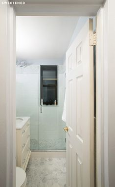 Upper East Side Bathroom with classic, marble Carrera hex tiles for the floor.