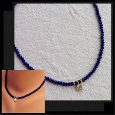 A personal favorite from my Etsy shop https://www.etsy.com/listing/516757077/dark-blue-crystal-necklace-blue