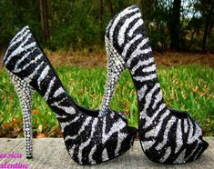 Zebra high heel shoes. Just can't fit in them yet.