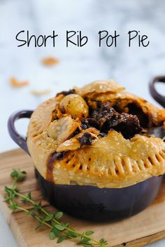 Short Rib Pot Pie - Luscious short ribs glazed with red wine and topped with flaky pastry.   foxeslovelemons.com: