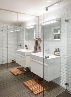 A wall of mirrors makes a small bathroom feel proportional