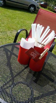 Food truck setup ideas - spray painted tin cans to hold napkins,  straws,  and hand wipes
