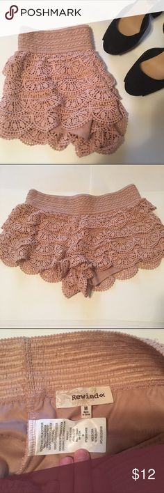 Pink Crochet Shorts These pink crochet shorts are very comfy. They have a thick elastic waist band at the top as well as a sheer lining on the inside. Rewind Shorts