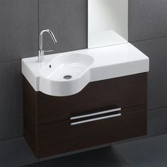 Badeværelsesmøbel i mørkt træ med håndvask i bordplade. MADE IN ITALY