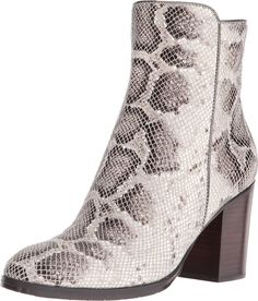 Donald J Pliner Women's Sonoma Taupe Python Glitter Boot. Dress up any contemporary ensemble in the versatile Sonoma bootie. Leather upper. Side zippered closure. Round toe. Leather lining. Lightly padded footbed. Stacked block heel. Leather and rubber sole. Imported. Measurements: Heel Height: 3 in Weight: 1 lb Circumference: 11 in Shaft: 7 1⁄2 in Product measurements were taken using size 8.5, width M. Please note that measurements may vary by size.