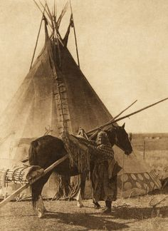 Transporting the ceremonial bag and tipi-cover of a Blackfoot society (The North American Indian, v. XVIII. Norwood, MA, The Plimpton Press, 1928)