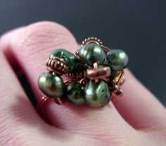 Love this ring! Copper and Green Pearl WireWrapped ringEmerald delight by beadsoul, $12.00