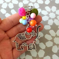 Happy elephant keychain - Clasp keychain / bagcharm with pompoms, beads and an elephant by FlorAccessoires