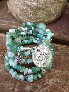 Beach Goddess: five wrap memory wire beaded bracelet with metal stamped charm on Etsy, $40.00