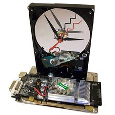 Hard Drive Clock with Rare Black Graphics Circuit Board with Fan as Base, a Great Geek Gadget.