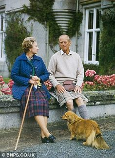 The Queen and Prince Philip with one of the royal corgis on a card from 1990