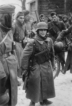 Léon Merdjian was the youngest soldier of the French Legion fighting with the Germans (Légion des volontaires français contre le bolchévisme - LVF). He belonged to 638.Infantry Regiment (Infanterie-Regiment 638, Französischer). In this photo he appears alongside his comrades outside the village of  Golovkova near Moscow on Dec 9, 1941. Merdjian and Léon Vatchnadzé, also 15 and volunteer, were Georgian emigres to France.