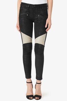 """The Shelby Custom Moto Pant has a super slim silhouette with a 27"""" inseam that hits above the ankle and a mid-rise to sit a little higher on the waist. It features super soft 100% black nubuck leather, zipper details at the hips, and contrasting white ribbed texture at back waistband and above the knees."""