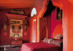 Pink and orange give this bohemian bedroom a really warm feel, love the shape of the built-in alcove by the bed giving the effect of drapes without actually needing to go to the length of installing them.