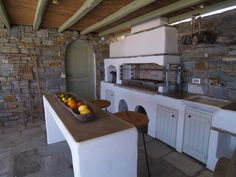 Open air kitchen with bbq spot, oven and marble sink. Concrete counters covered by cement mortar. Stone Bbq, Mexican Style Kitchens, Paros Greece, Paros Island, Greek House, Bbq Area, Concrete Counter, Beautiful Space, Outdoor Living