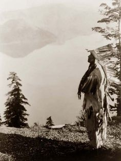 "I really feel this.  ""Praying Spirits"" taken at Crater Lake.  It was created in 1923 by Edward S. Curtis.    The picture presents a Klamath Indian chief in feather headdress standing on a mountain overlooking Crater Lake, Oregon.    Contact curator@old-picture.com."