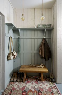 An Inglis Hall boot room with oak panelling, a high shelf, coat hooks and a bespoke bench also in oak