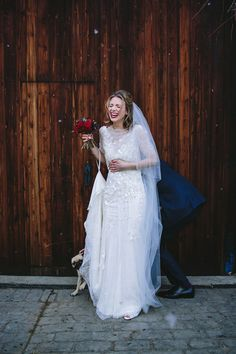 Laura wears 'Mimosa' by Jenny Packham for her winter wedding on the family farm in York. Photography by Kate Gray.
