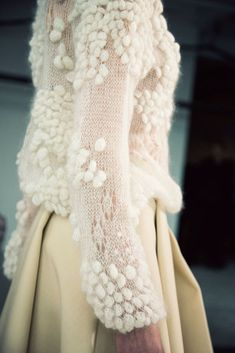 Delicate Knit with Pom Poms