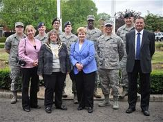 Ely Town Council gives thanks to Airmen.6/10/2013 - Ely Town Council members pose for a group photo with Airmen June 10, 2013, at RAF Mildenhall, England. More than 90 Airmen from various bases throughout the U.K. assisted with the set up and tear down of Christmas lights throughout the town. (U.S. Air Force photo by Staff Sgt. Jerilyn Quintanilla/Released)