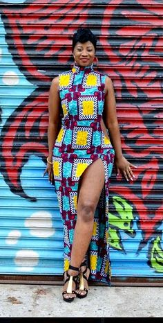 Bold, beautiful and sexy!!! That's what this dress is. Blue, red, white and yellow. Comes with a high neck, cut out sides and a high split up to the thigh. High neck, cut out sides, high split african print dress. Ankara   Dutch wax   Kente   Kitenge   Dashiki   African print bomber jacket   African fashion   Ankara bomber jacket   African prints   Nigerian style   Ghanaian fashion   Senegal fashion   Kenya fashion   Nigerian fashion   Ankara crop top (affiliate)