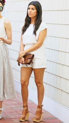 Kourtney Kardashian concealed her barely there bump (and showed off her gorgeous tan) in a white romper while filming scenes for Kourtney and Khloé Take the Hamptons in Southampton, N.Y.
