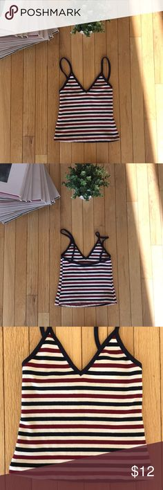Brandy Melville Stretchable Crop Tank Dark red, dark blue and creme striped tank. Meant to be very small and then stretches into a cropped tank. Never worn Brandy Melville Tops Tank Tops