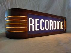 Patterned after the classic RCA studio warning light, ours is handmade from selected hardwoods, cast acrylic and back lit by a long-lasting led light source. 13 7/8 L x 2 5/8 w x 3 3/8 h.  Polyurethane topcoat.  Perfect for a recording studio, an artists music room or as a very cool nightlight.  Suitable for wall mounting. Keyhole slots in the back and an included mounting template.  There are 3 wiring options ...  bare wire for permanent installation by a licensed electrician....