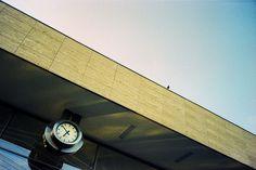 6:51 PM Olympus Mju II Fuji Sensia 100 expired in 2006 cross processed in C41 (pushed one stop) xpro crossprocess e6 film c41 analog olympus mju sensia fuji filmisnotdead buyfilmnotmegapixels clock station bird pigeon color vivid blue yellow