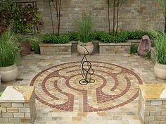 Pavior labyrinth - such wonderful stone colours and enclosed in a space which almost begs you to relax.