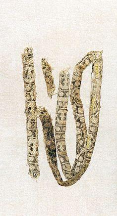 "Collar of a caftan - Six Dynasties, ca. 8th century A.D. Caucasus region. Silk 0.5"" wide x 22.75"" long."