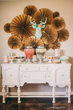 dessert table decor with the mint green faux deer head and felt floral crown!