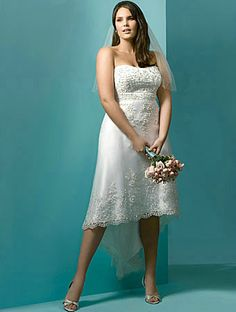 This charming Lace over Satin High Low Wedding Dress is beautifully made with a strapless bodice with crystal beading and pearls, and a modified Sweetheart Neckline  This style of gown is ideal for a Beach or Destination Wedding, or a Civil or Back yard Wedding