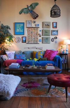 Fascinating Wall Art Decor On Bohemian Living Room Plus Blue Slip Cover Sofa With Throw Cushions Also Round Tufted Table